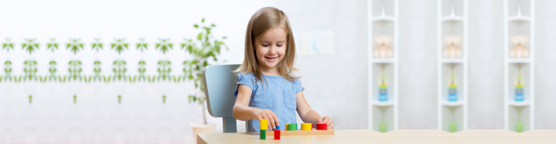 child girl playing with educational toys
